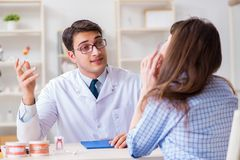 The patient visiting dentist doctor for preliminary appointment. Patient visiting dentist doctor for preliminary appointment Royalty Free Stock Images
