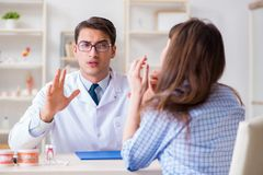 The patient visiting dentist doctor for preliminary appointment. Patient visiting dentist doctor for preliminary appointment Stock Images