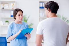 Patient visiting doctor for annual regular check-up in hospital. Clinic Royalty Free Stock Photo