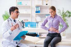 The patient visiting doctor for medical check-up in hospital Royalty Free Stock Image