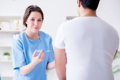 Patient visitng doctor for annual flu shot inoculation for preve. Ntion Stock Image