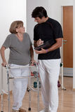 Patient with Walker and Physician. Patient with walker discusses his progress Royalty Free Stock Photo