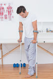 Patient walking with crutch Royalty Free Stock Photo