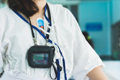 Patient wearing holter monitor device for monitoring of an elect. Rocardiogram 24 hour Heart investigation activity. woman in the hospital. Healthcare concept Royalty Free Stock Images