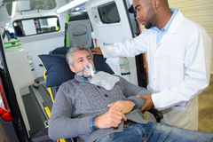 Patient wearing oxygen mask Stock Photos