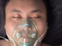 Patient wearing oxygen mask. Closeup of male patient wearing oxygen mask royalty free stock photos