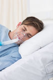 Patient wearing oxygen mask in hospital Stock Image