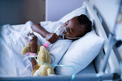 Patient wearing oxygen mask while sleeping Stock Images