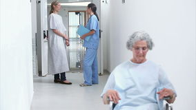 Patient with a wheelchair in a hallway Royalty Free Stock Photography