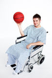 Patient in wheelchair holding a basket ball Stock Photography