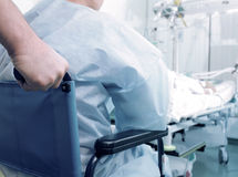 Patient in wheelchair in the ICU Stock Photo