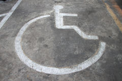 Patient wheelchair sign on parking floor Stock Images