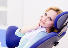 Patient woman at the dentist complains of toothach Stock Photos