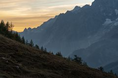 Sunset behind different mountain ranges royalty free stock image