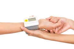 Patients arm with glucose measure meter around wrist and doctors hands holding supporting Royalty Free Stock Photos