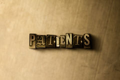 PATIENTS - close-up of grungy vintage typeset word on metal backdrop Stock Photos