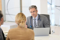 Patients consulting doctor specialist stock images