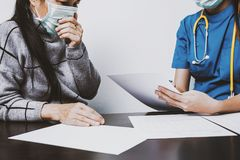 Patients are consulting with the nurse royalty free stock photo