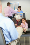 Patients In Doctor's Waiting Room Royalty Free Stock Images