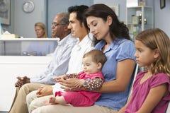Patients In Doctors Waiting Room Stock Photos