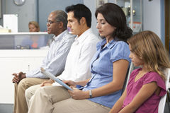 Patients In Doctors Waiting Room Royalty Free Stock Images