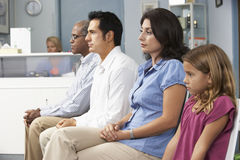 Patients In Doctors Waiting Room Stock Photos