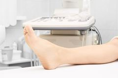 Patients foot. Medical research. Doctors work. Light white background. Hospital Stock Photography