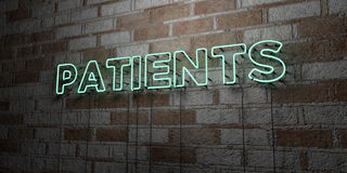 PATIENTS - Glowing Neon Sign on stonework wall - 3D rendered royalty free stock illustration. Can be used for online banner ads and direct mailers Royalty Free Stock Image