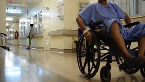 Patients with head injury on wheelchair stock footage