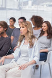 Patients listening in a therapy session stock images
