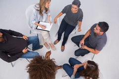 Patients listening to each other in group session stock photos