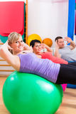 Patients at physiotherapy on training balls Stock Photo