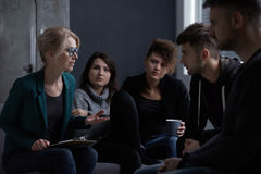 Patients of rehab centre. Therapist talking with patients of rehab centre Stock Images