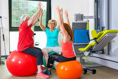 Patients on stability balls doing exercises Stock Images