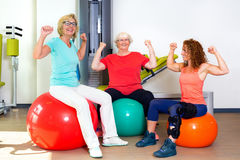 Patients and trainer flexing bicep muscles Stock Image