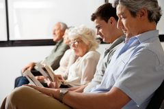 Patients Waiting In Lobby Stock Photography