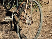 Patina bike. Old rustic patina bike left in field Stock Images
