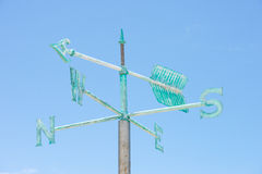 Patina green weather vane blue sky background Royalty Free Stock Images