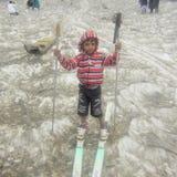 Patins da criança no gelo Fotografia de Stock Royalty Free