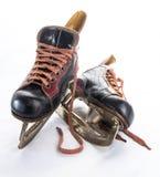 Patins de hockey sur glace d'antiquité Images libres de droits