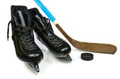 Patins et bâton d'hockey Photographie stock