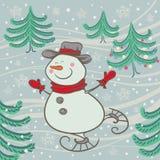Patins gais de bonhomme de neige Photo stock