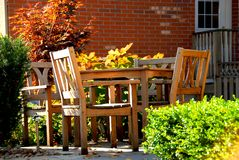 Patio. House patio with natural wooden patio furniture Stock Photos