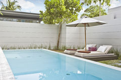 Patio. Image of nice modern  summer patio with swimming  pool Stock Photos