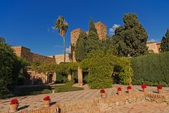 Patio of the Alcazaba moorish castle, Malaga. Patio with flowers and trees of the Alcazaba moorish castle, Malaga, surrounded by green plants on a sunny day with Royalty Free Stock Images