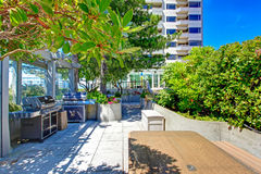 Patio area with barbecue. Residential building in downtown, Seat Stock Image