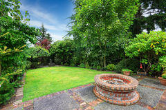 Patio area with brick brick fire pit Royalty Free Stock Photography