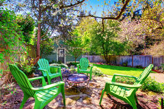 Patio area with green chairs and natural stone floor. Royalty Free Stock Photos
