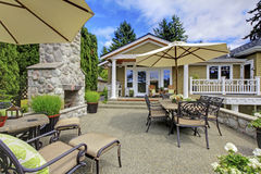 Patio area with stone fireplace and concrete floor. Stock Photography