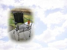 Patio chair and sky postcard Royalty Free Stock Images